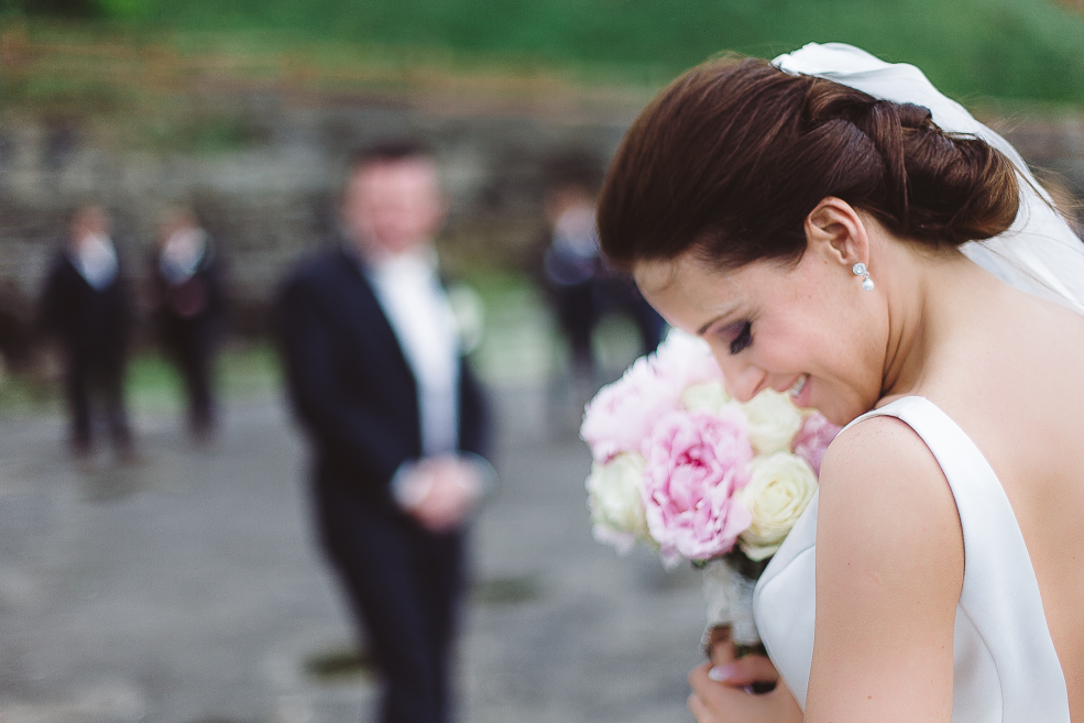 A bride holding a flower