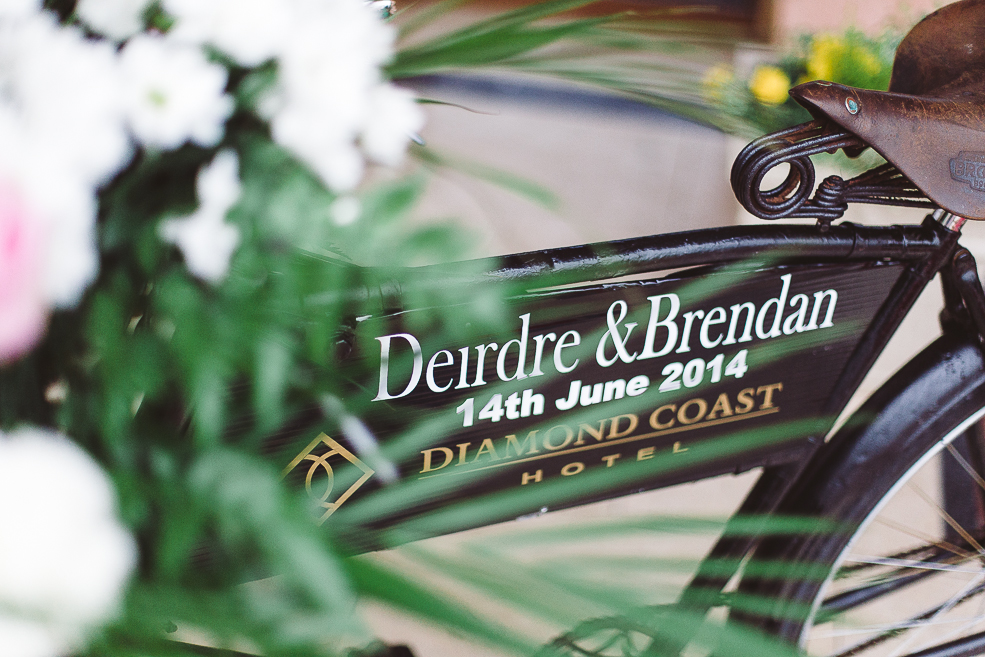 A close up photograph of a wedding bike with sign