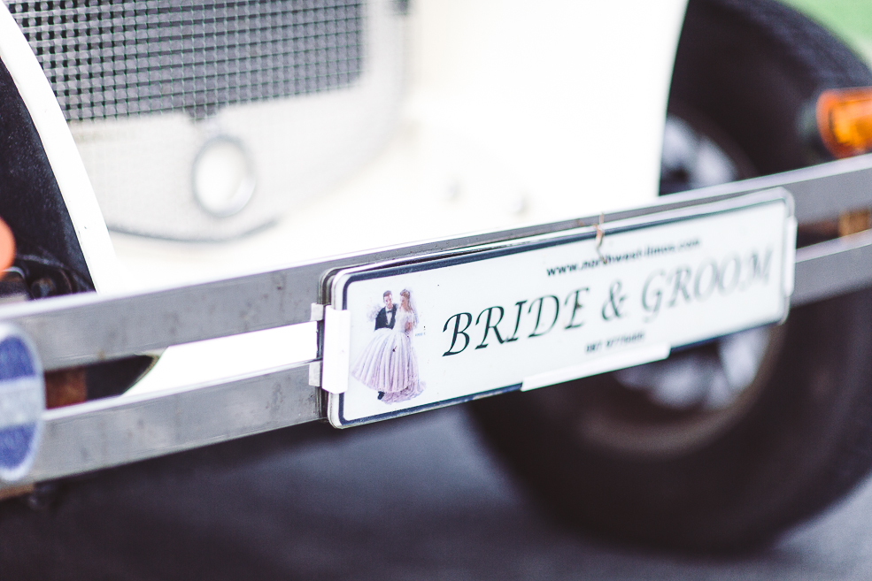 A close up of a wedding car