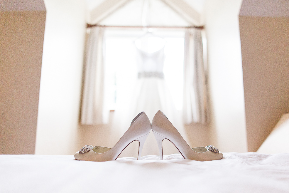 The wedding shoes lying on a bed
