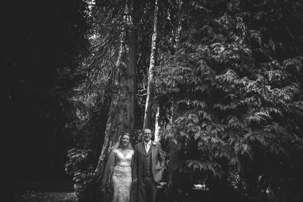 A group of people standing next to a tree