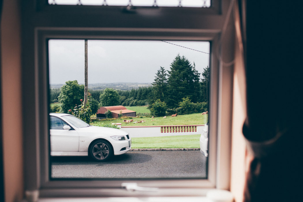 A white car in front of a window