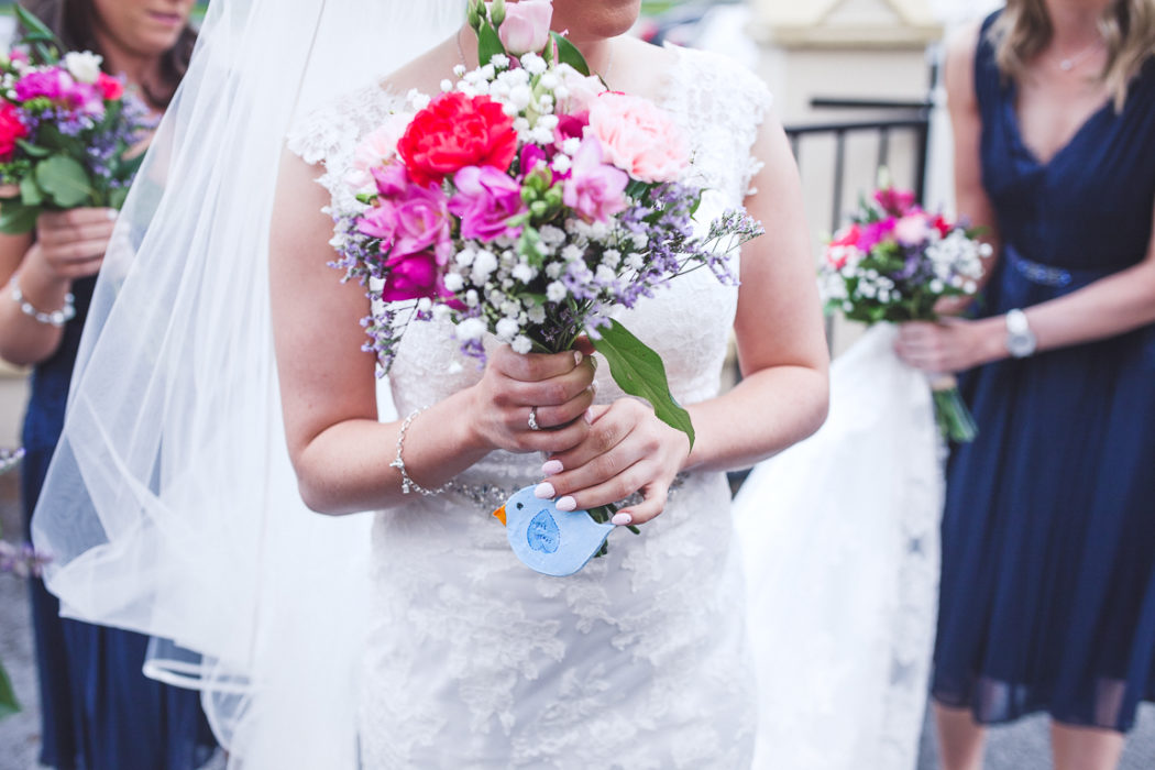 A woman in a wedding dress holding a flower