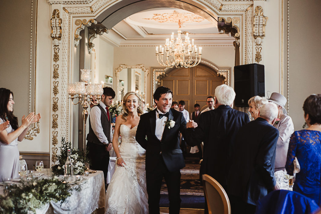 A bride nad groomstanding in a room