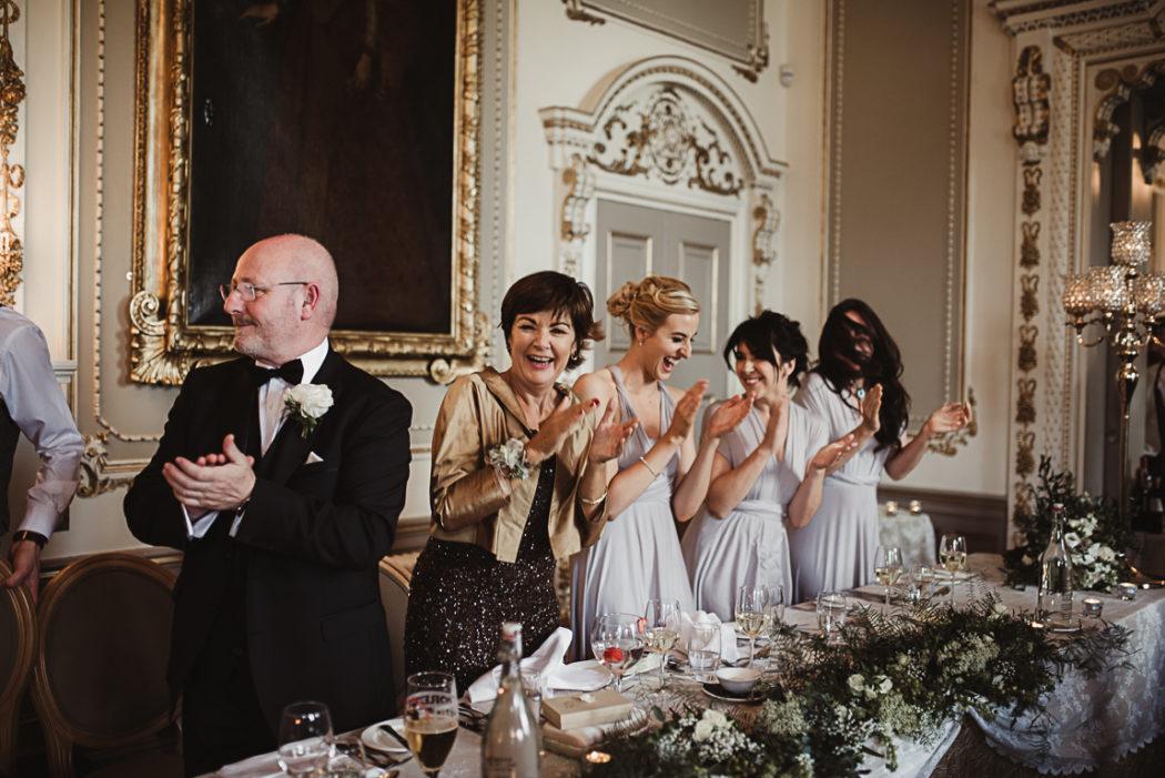 Wedding guests applaud