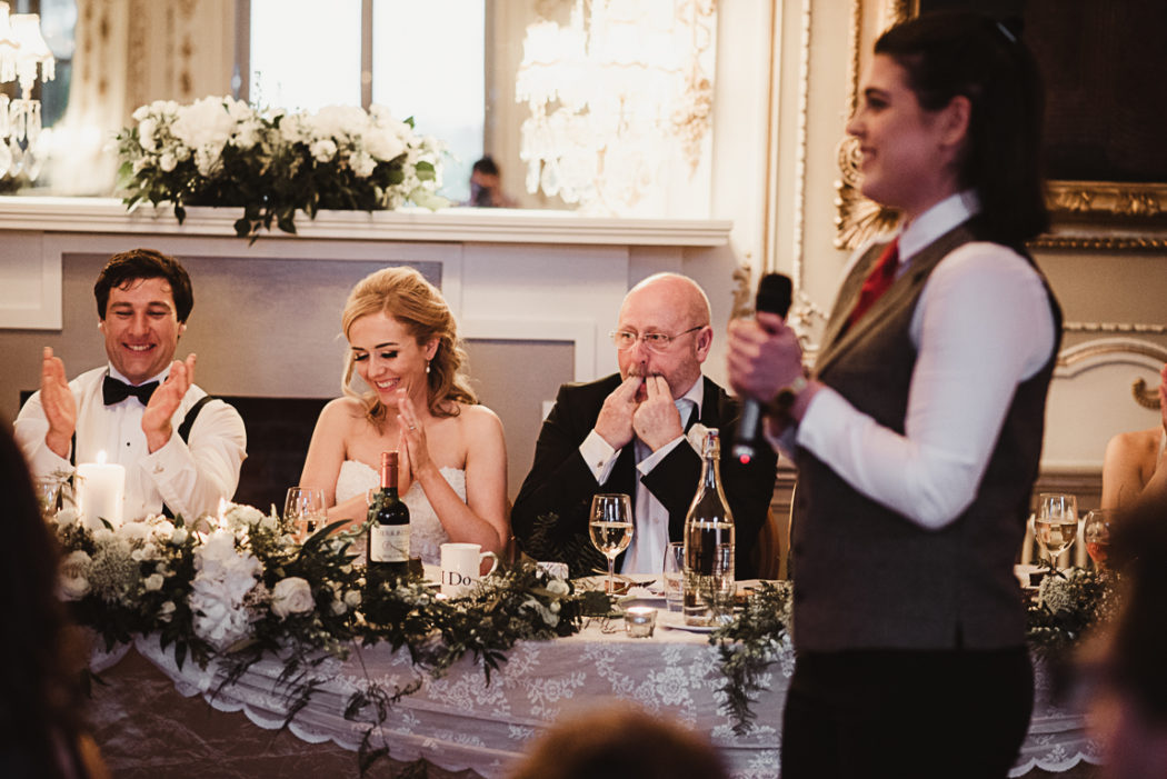 A group of people sitting on the wedding