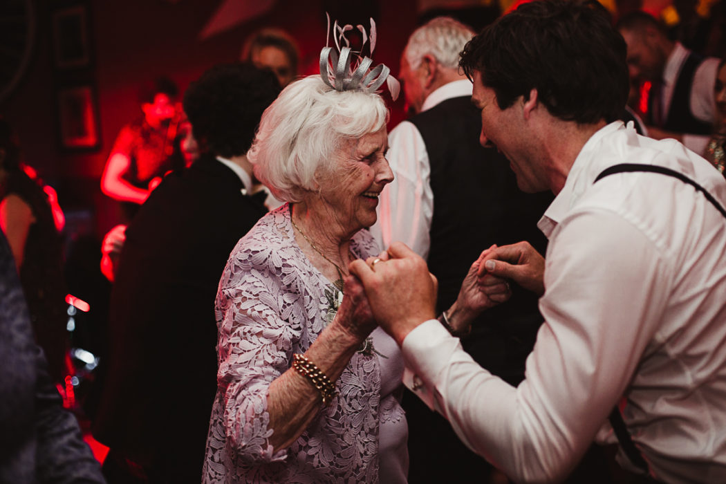A couple of people that are dancing on the wedding party