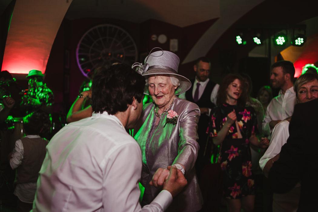 The elder dancing with groom