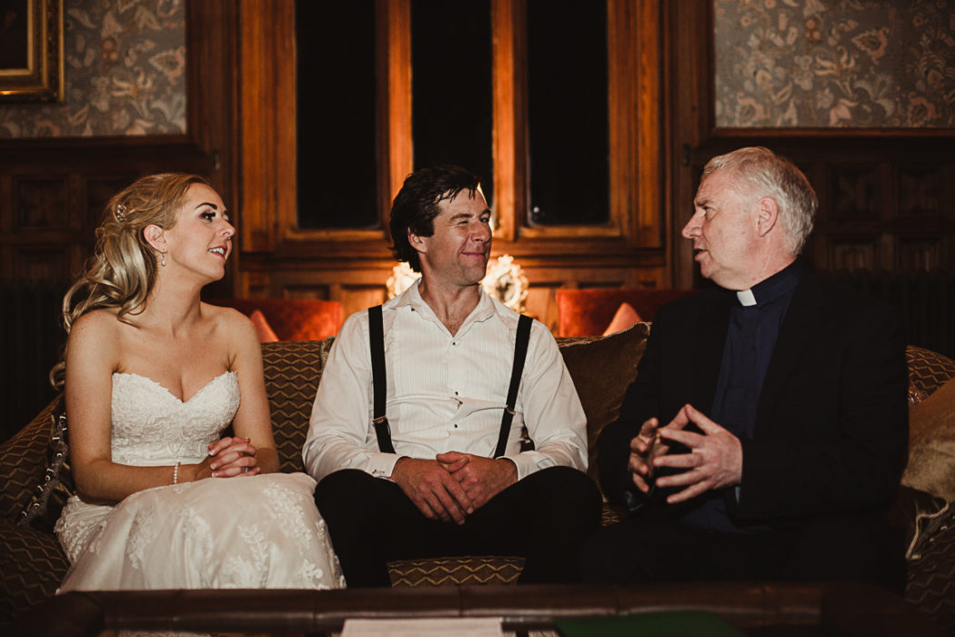 Newlyweds talking to a priest