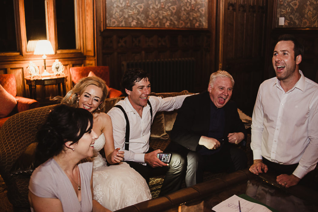 Bride, Groom and priest laughing