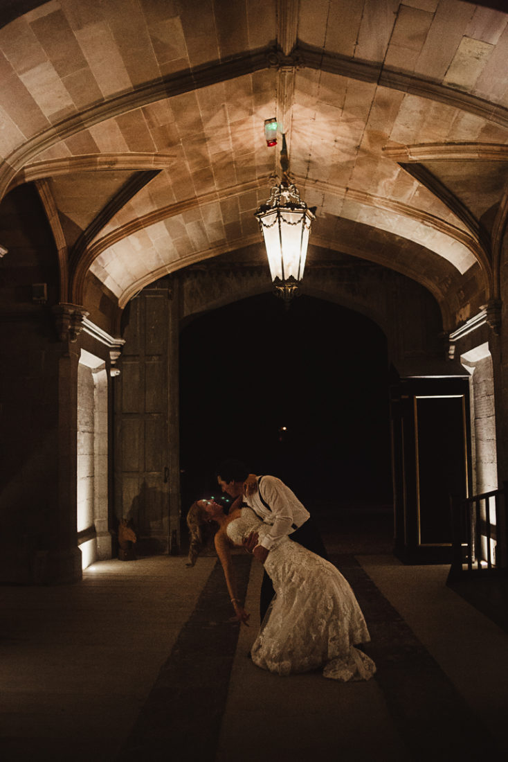 The newlyweds holding each other while dancing
