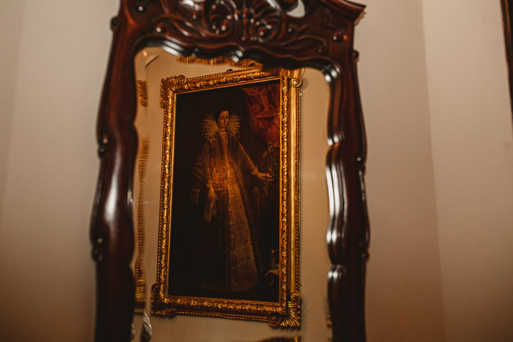 A clock sitting in front of a mirror posing for the camera
