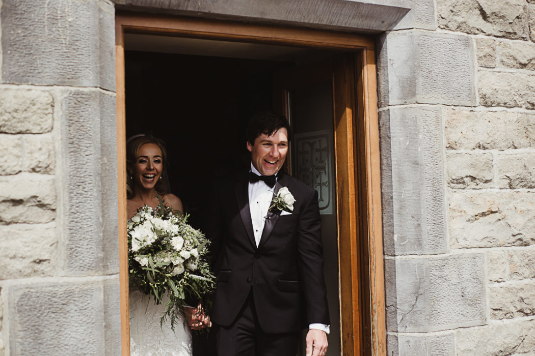 Wife and husband walking out of church