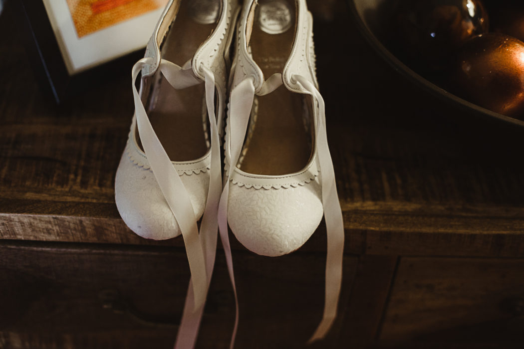 A pair of white shoes on a table