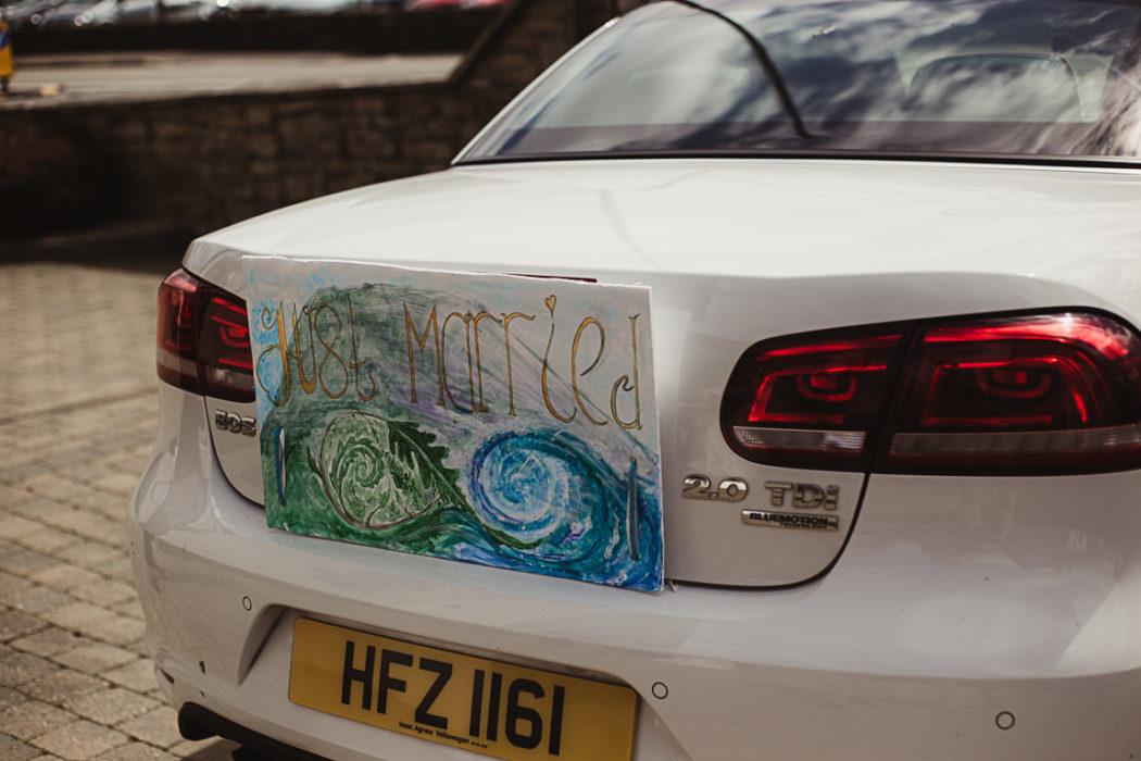 A close up of a wedding car