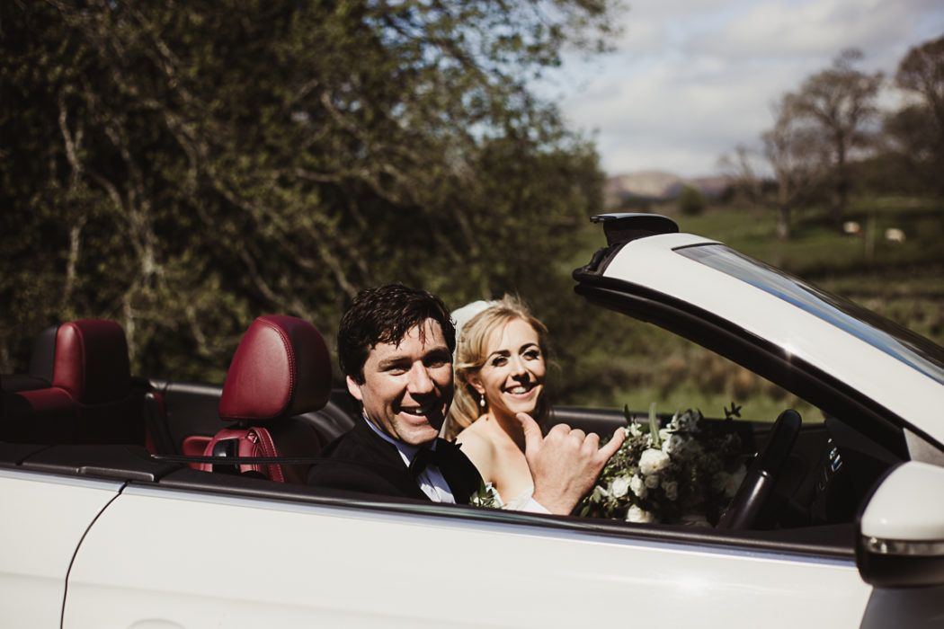 The newlyweds in a car