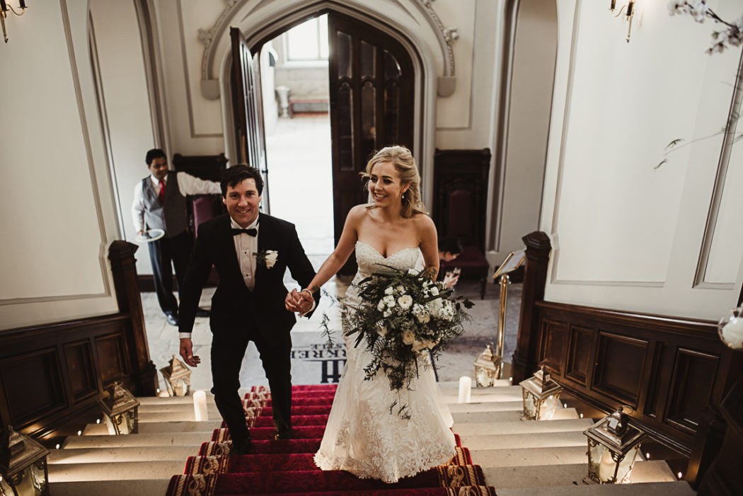 The newlyweds on stairs