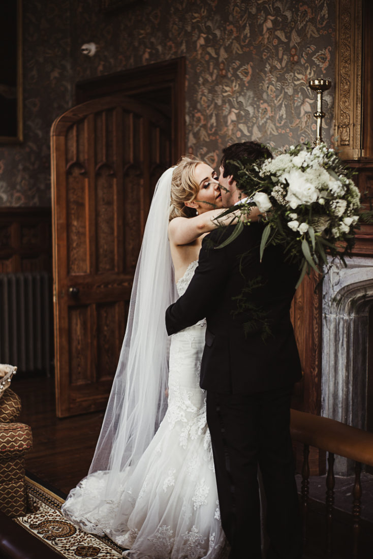A bride wearing a wedding dress holding the groom