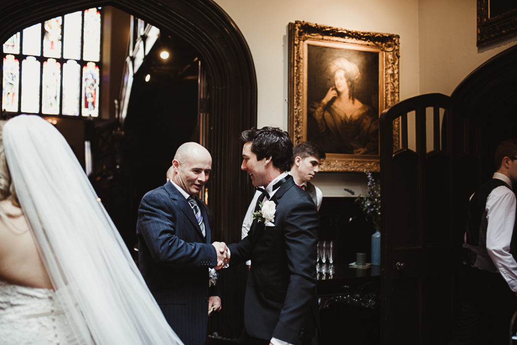 The groom welcomes family