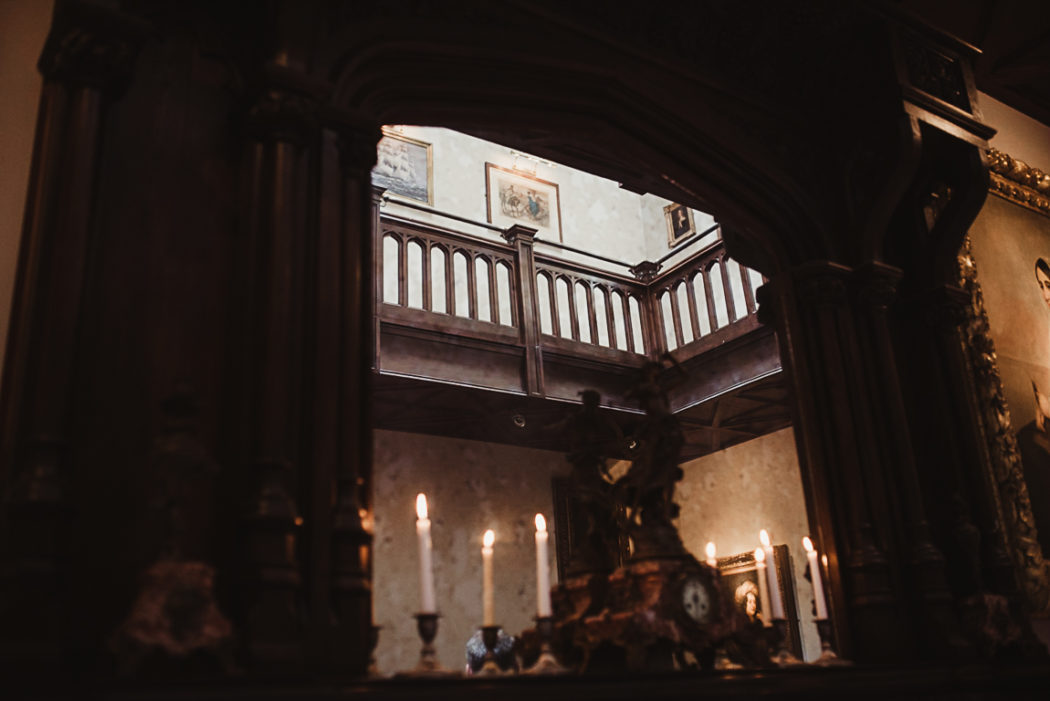 A dark hall with candles