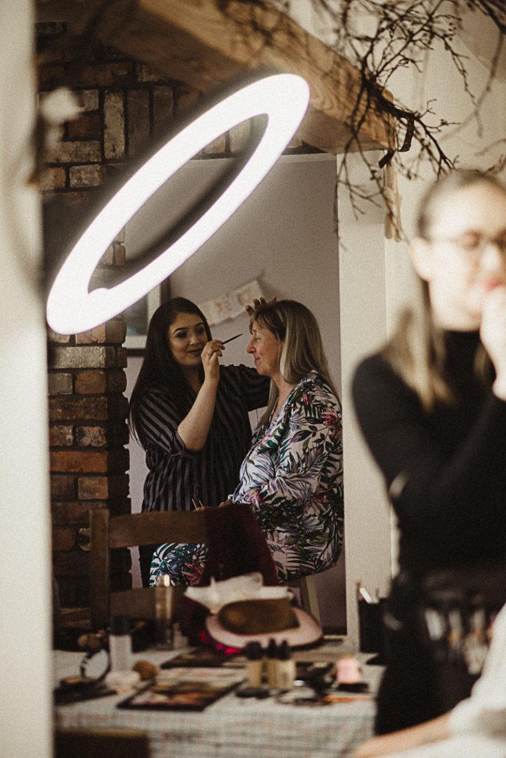 Women doing makeup before the wedding ceremony