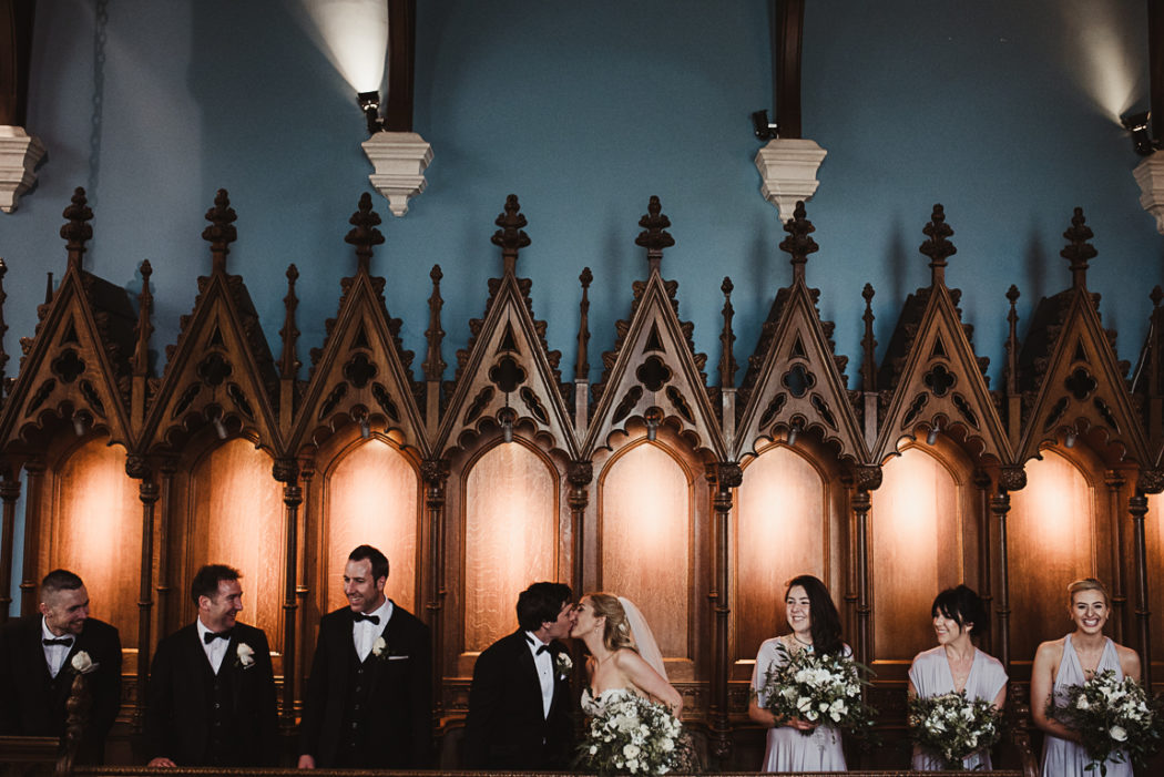A group of people standing in a chapel