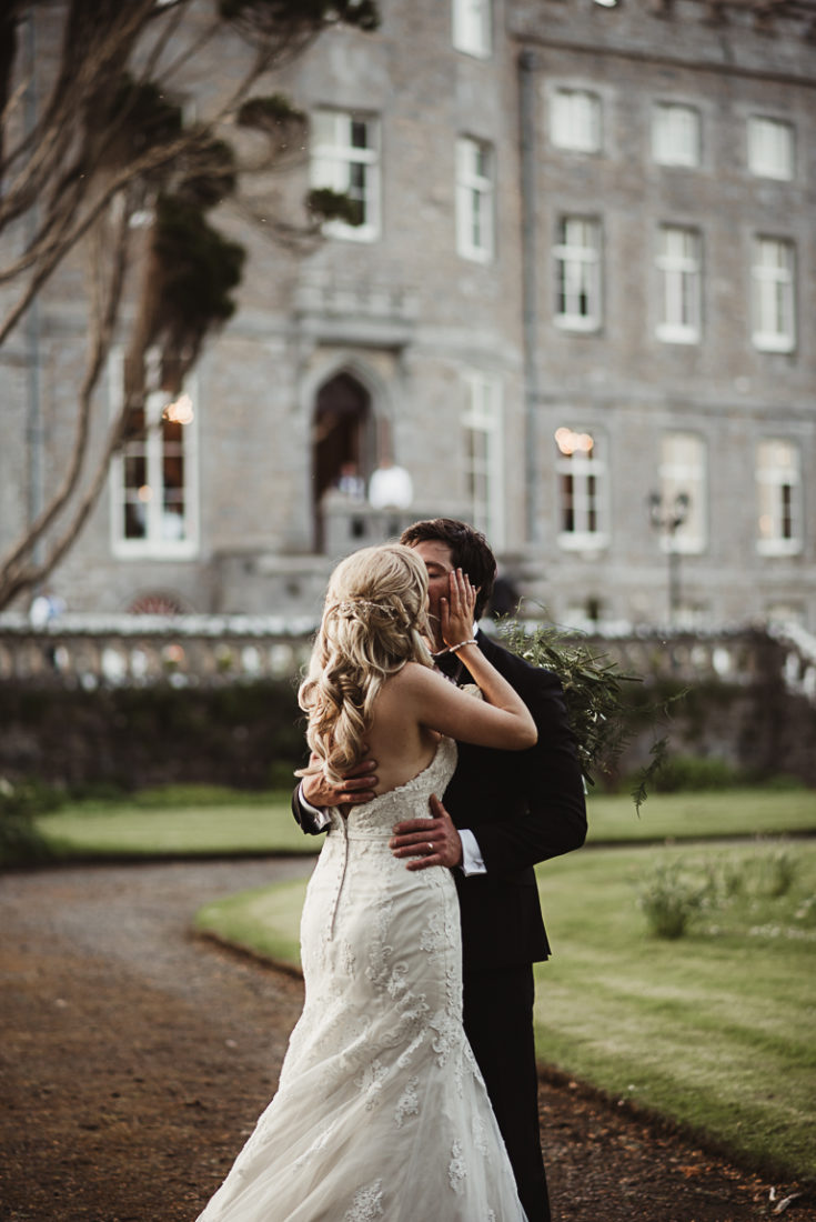 Couple kissing in front of Markree Castle