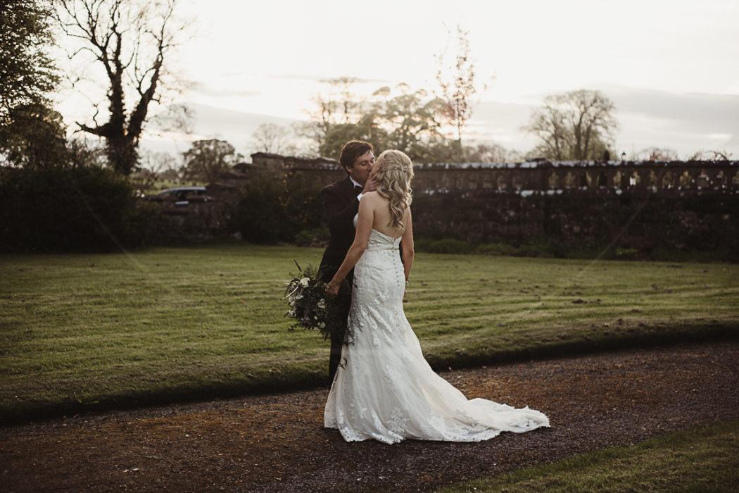 Photograph of newlyweds kissing