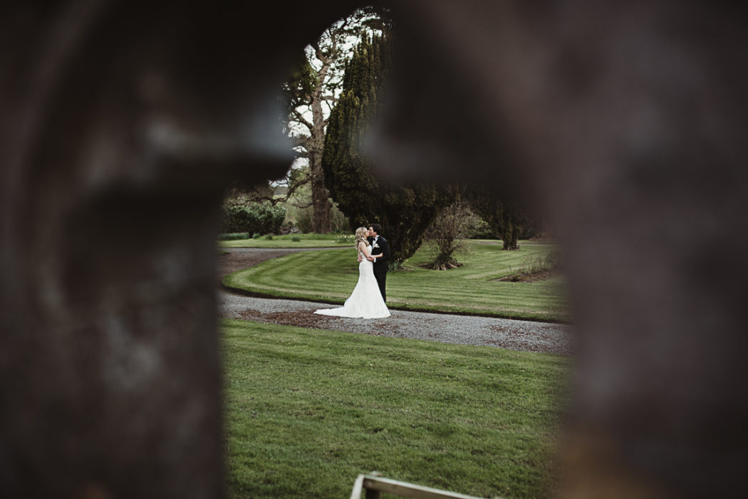 The bride and groom in a green field