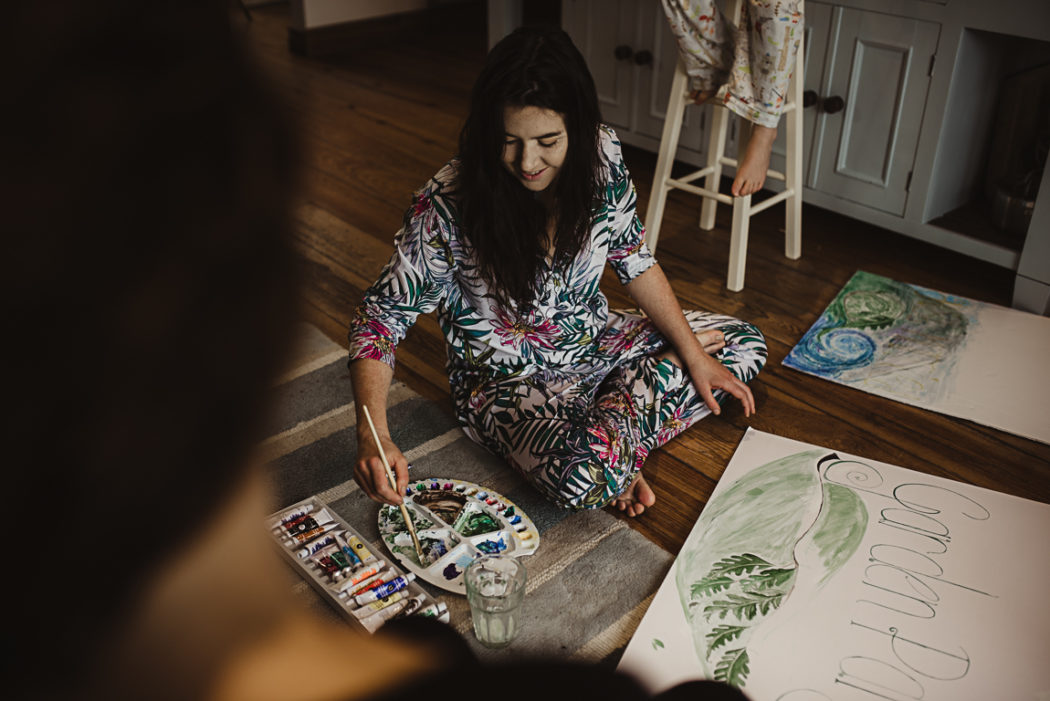 Woman painting on the floor