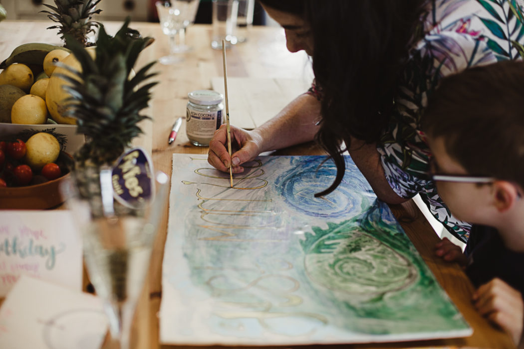 A person painting at a table