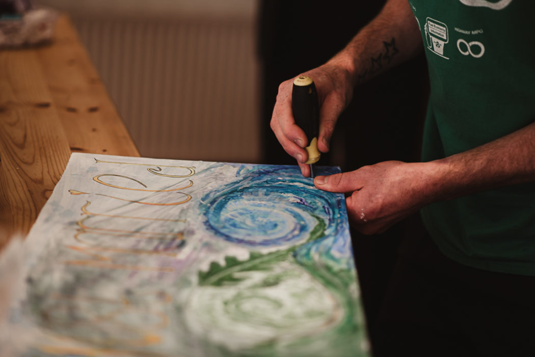 Hands making a painting