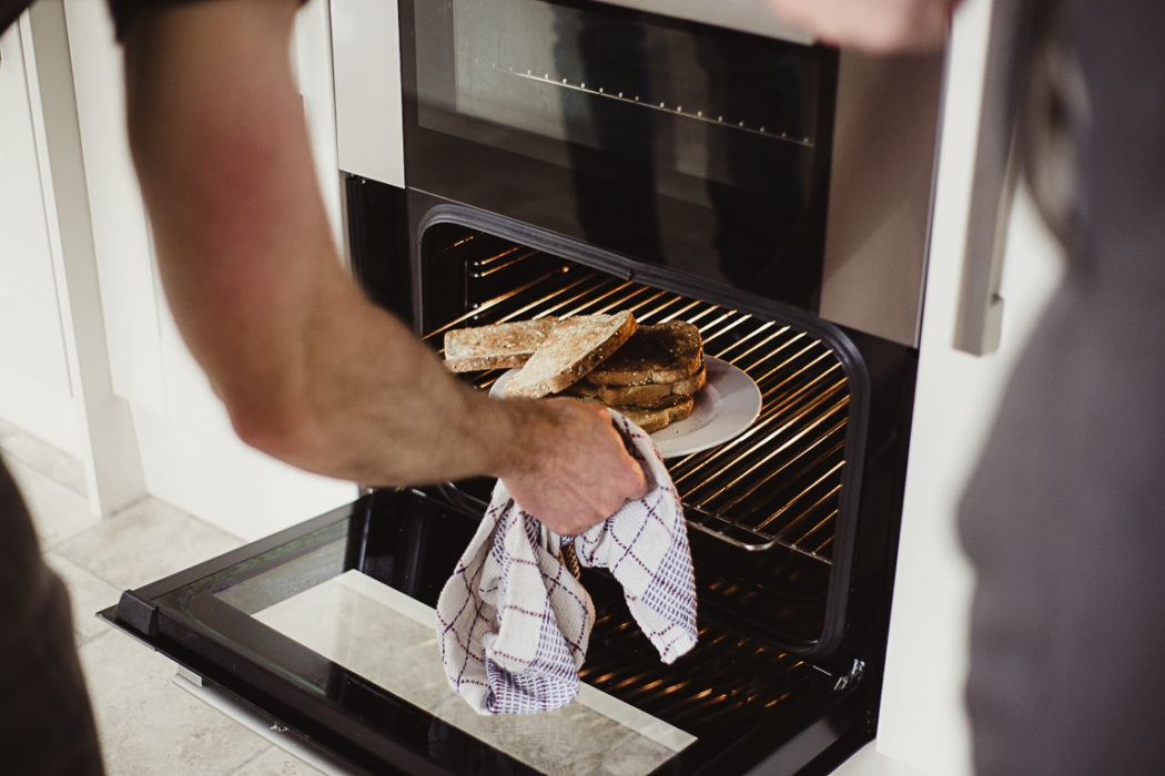 A person cooking in an oven