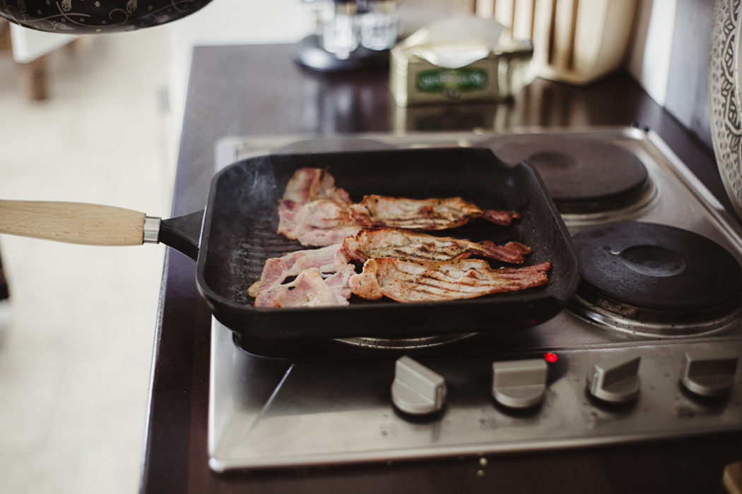 A food sitting on top of a pan on a stove