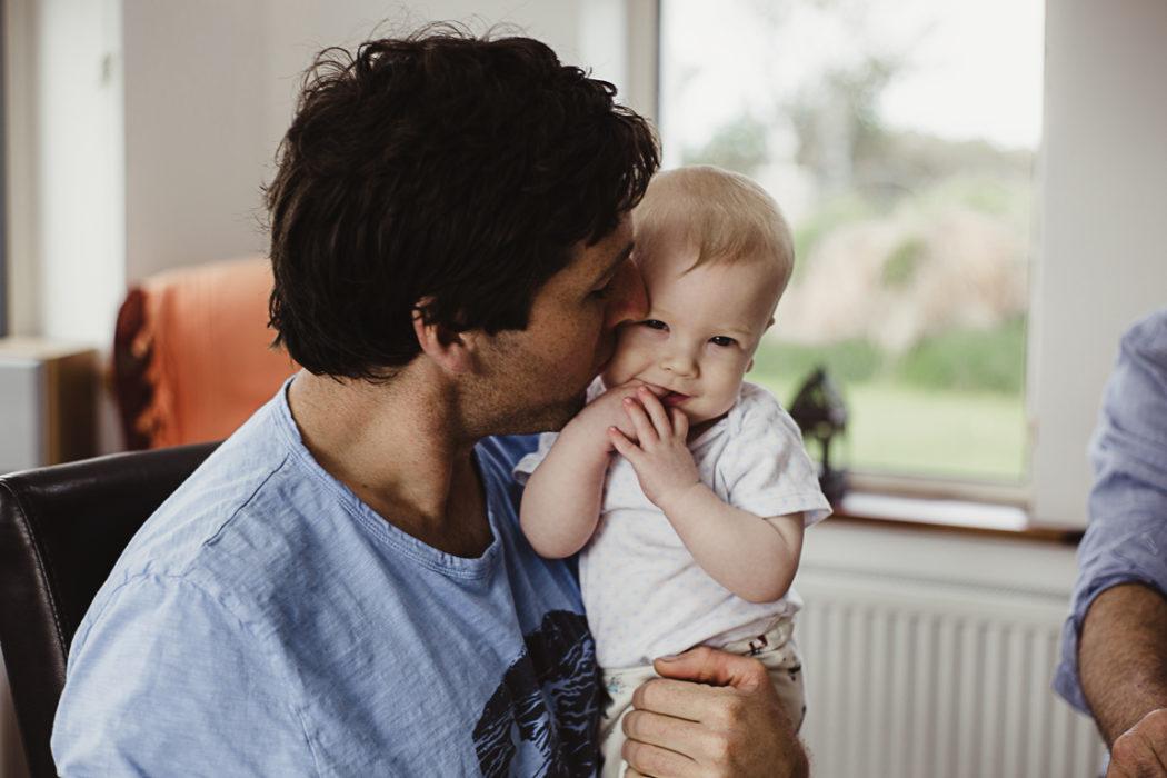 A man kissing a child
