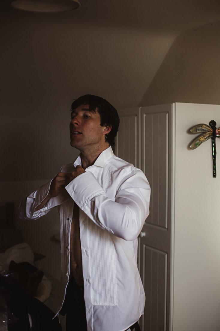 A groom wearing a shirt