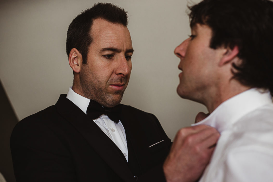 A comrade helping groom