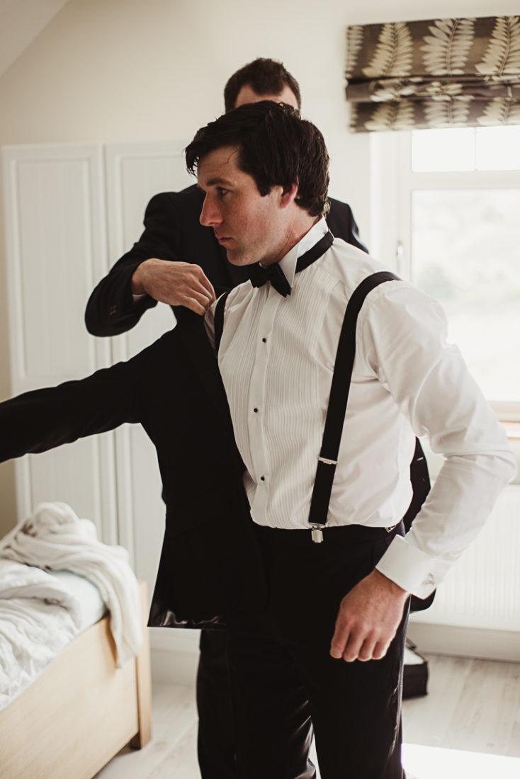 A groom wearing a jacket