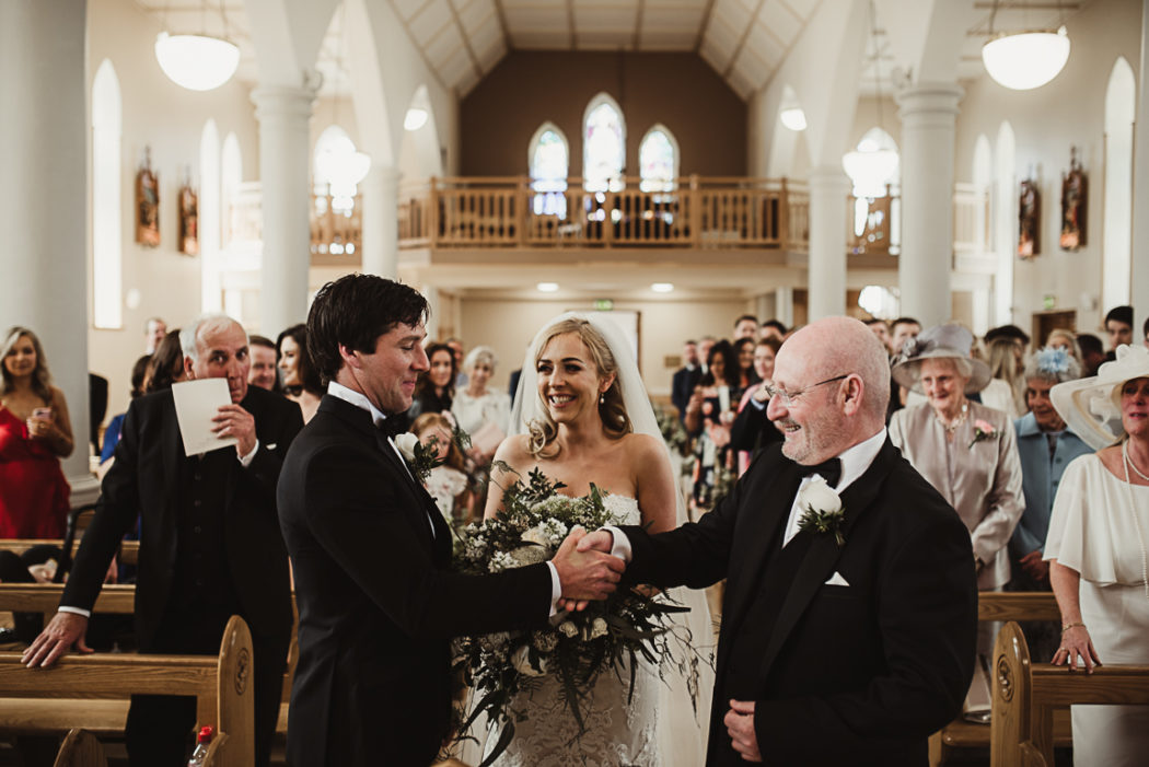 Wedding guests and th newlyweds standing in the church