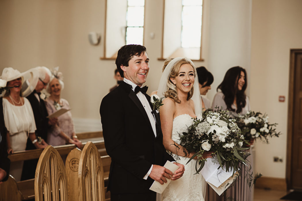 A man and a woman in a wedding dress