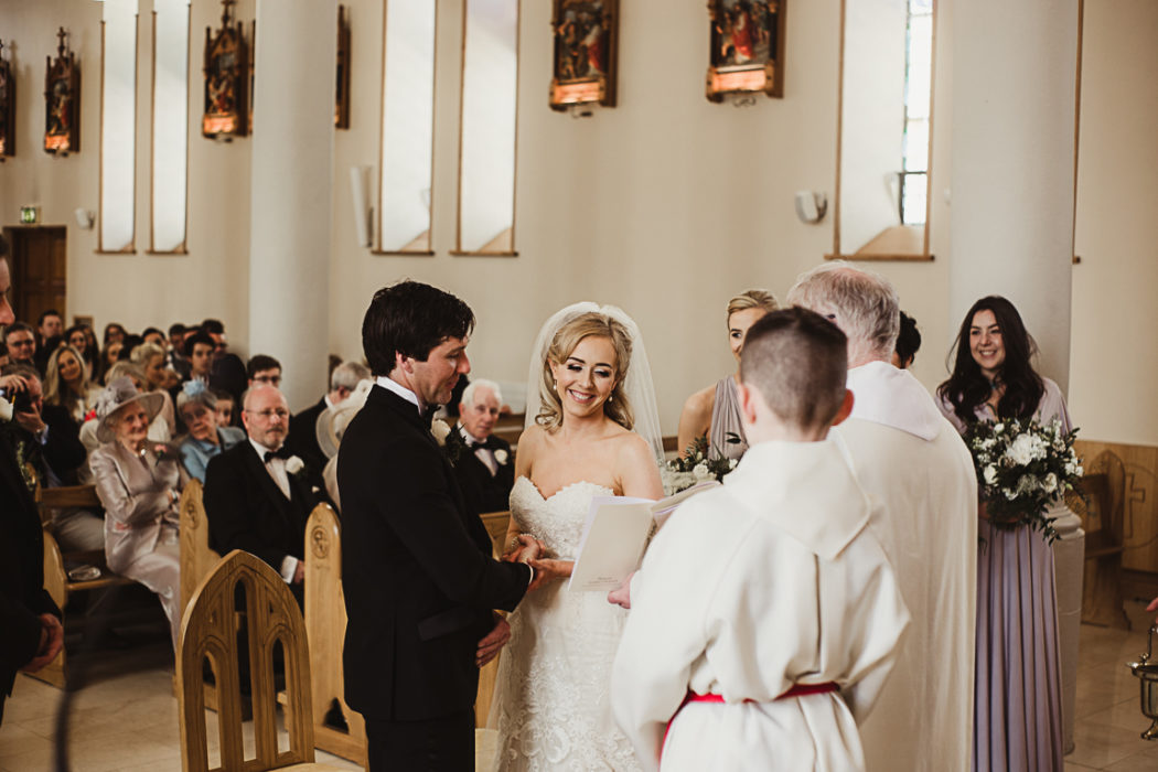 The newlyweds in church during the ceremony