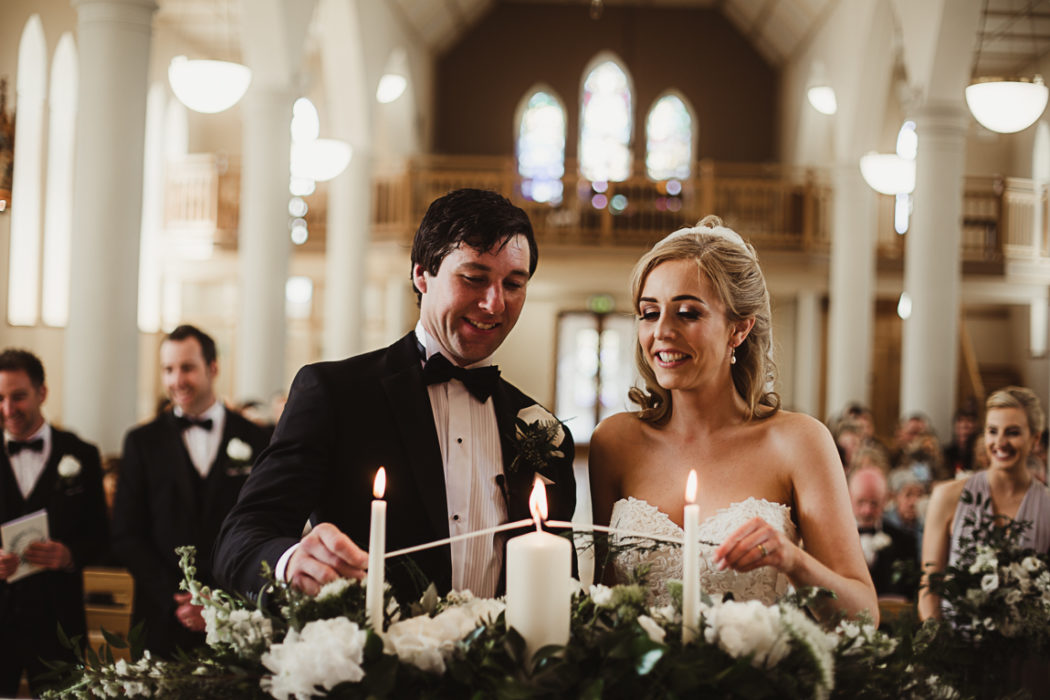 Wife and a husband lighting a candle