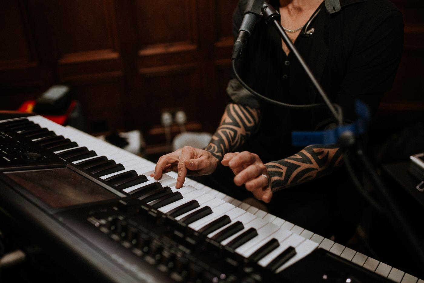 A man sitting on a piano keyboard