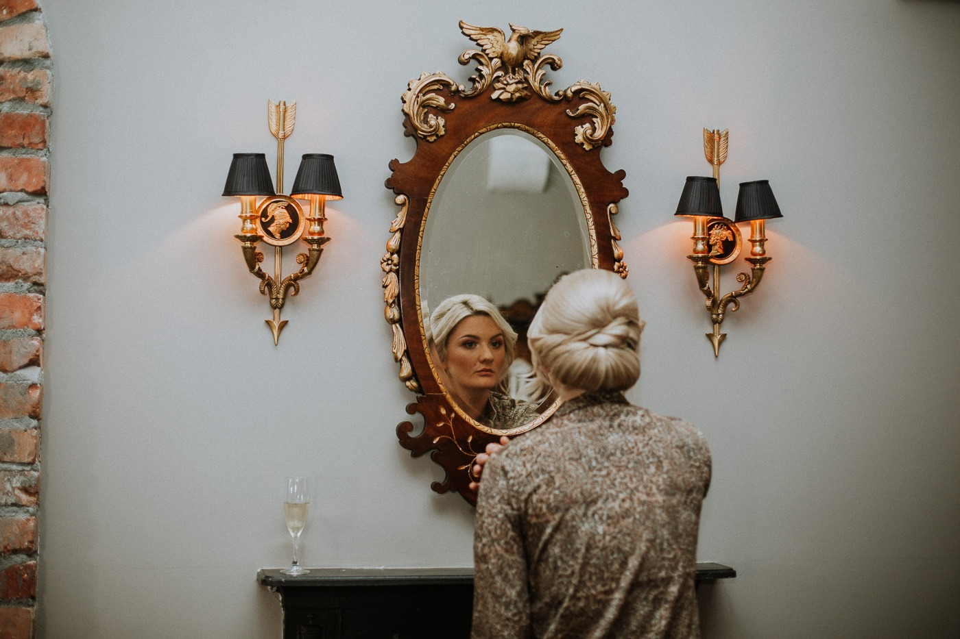 A statue in front of a mirror posing for the camera