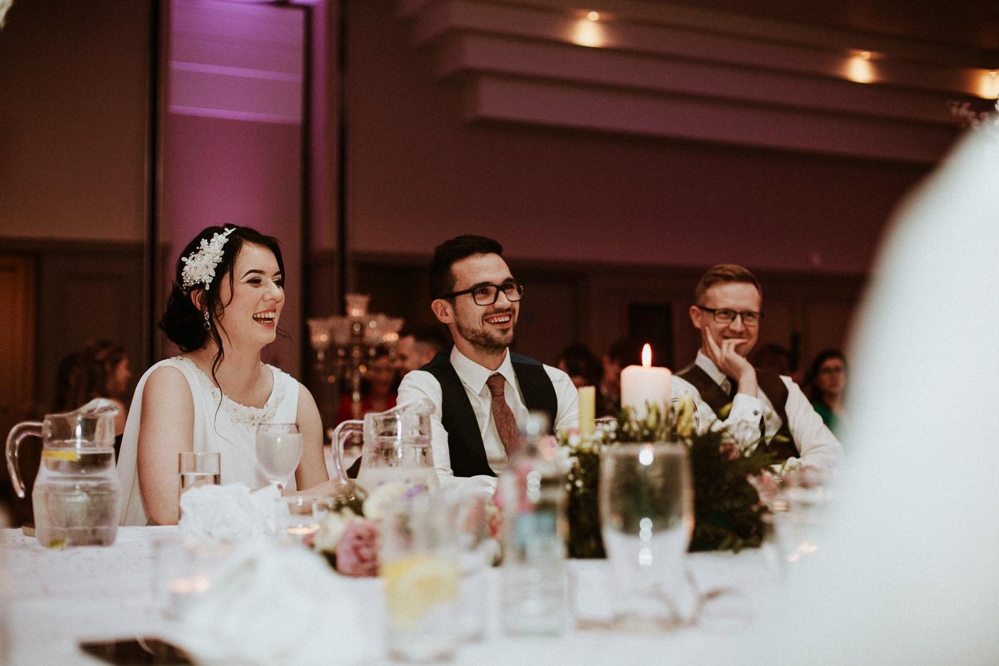Lara St. John et al. standing around a table with wine glasses