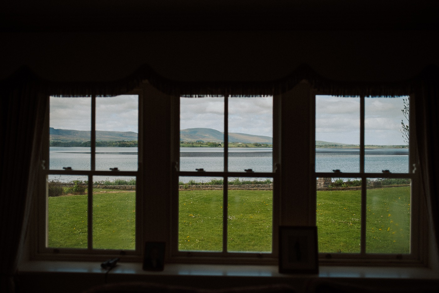 A view of a body of water in front of a window