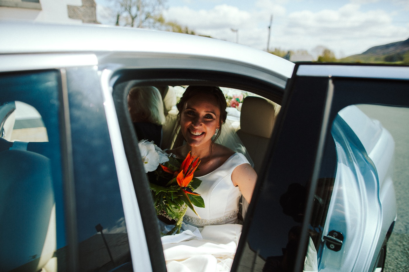 A person sitting in a car