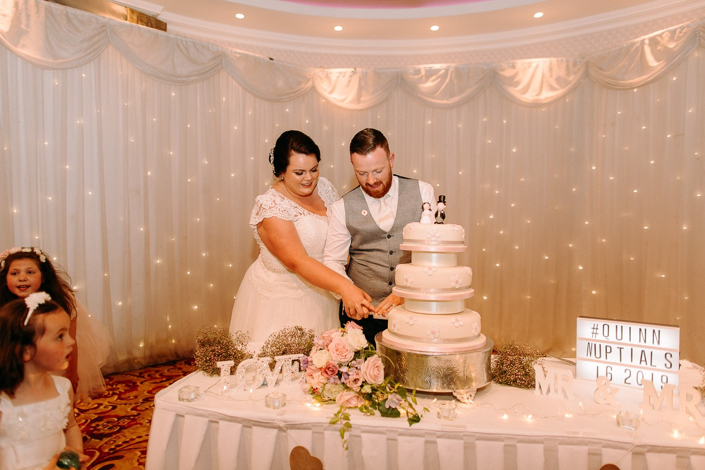 A couple cutting their wedding cake