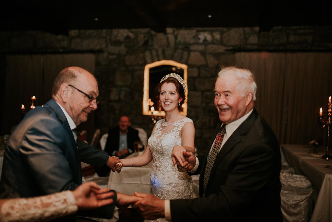 Caroline Kenny et al. holding wine glasses