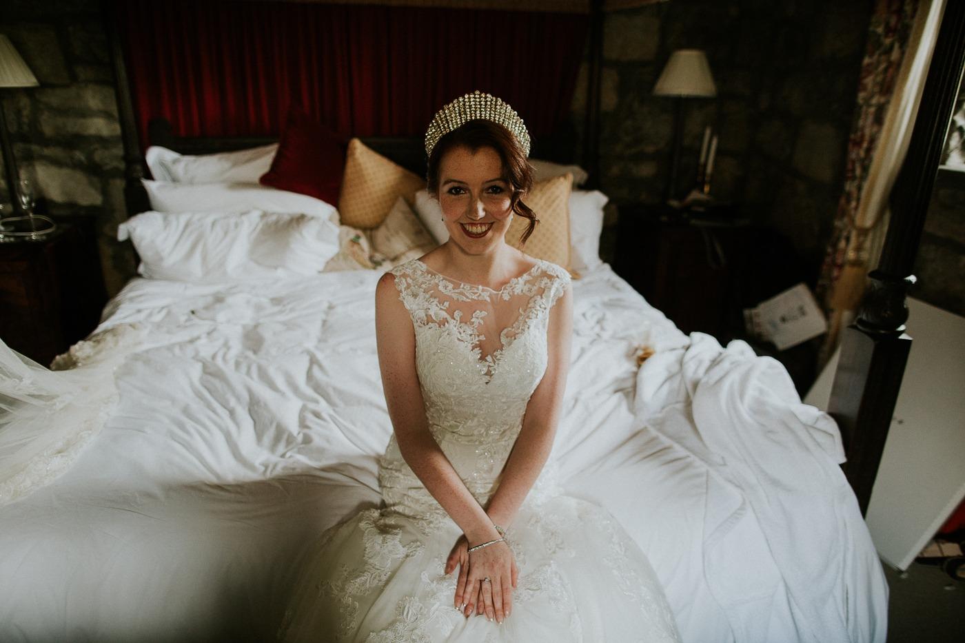 Caroline Kenny sitting on a bed